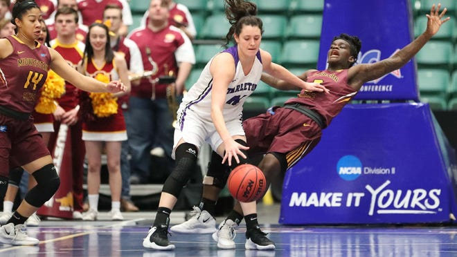 Midwestern State's Annette Dukes looks to draw the charge against Tarleton State's Mackenzie Hailey Friday in Lone Star Conference Tournament action.