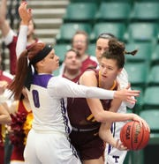 Midwestern State's Hannah Reynolds looks to make a pass Friday against Tarleton State.