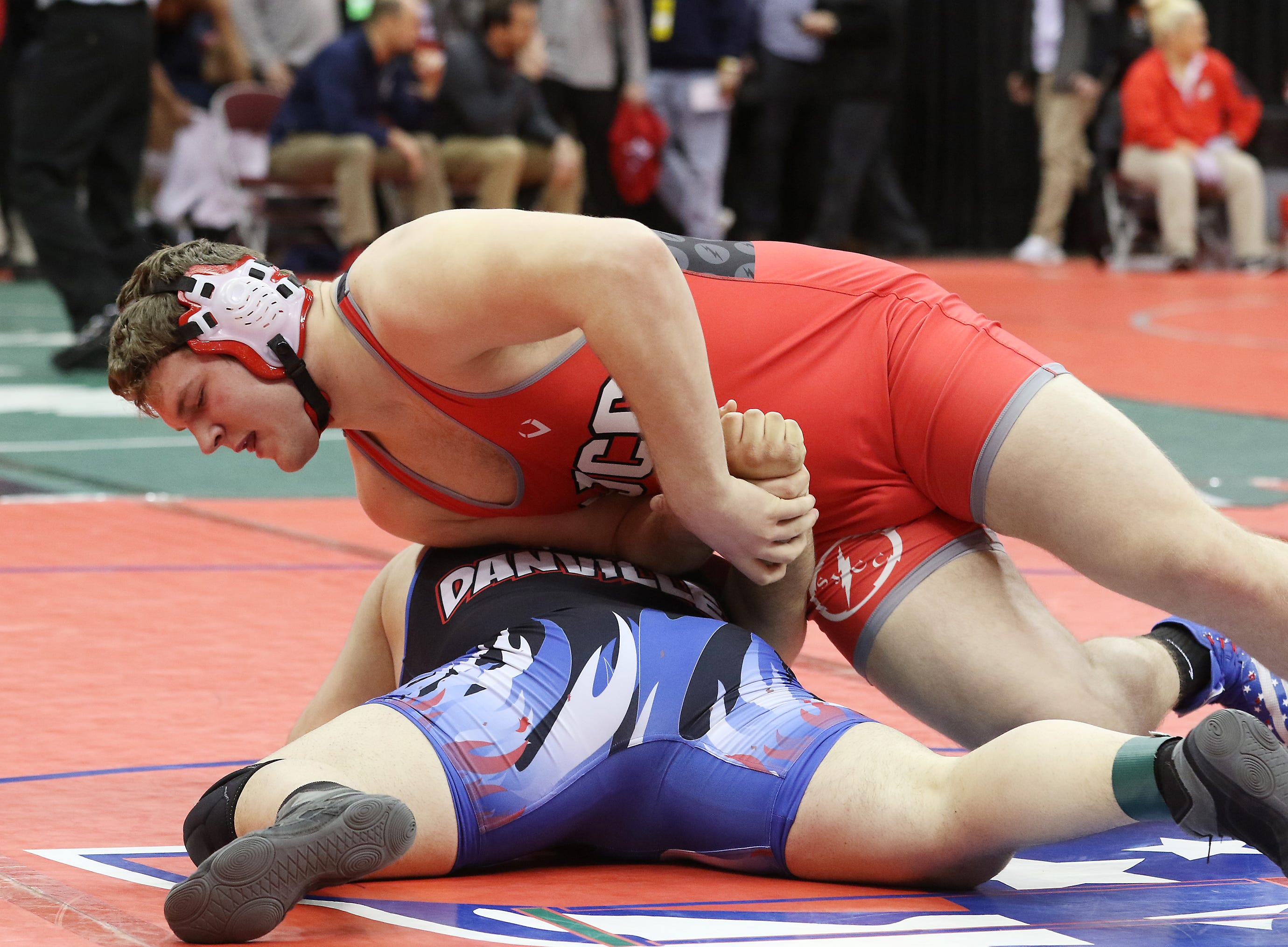 Fremont St. Joseph's Noah Price wrestles Danville's Dylan Wilson in the 285 pound weight class at the Division III state wrestling tournament on Friday.