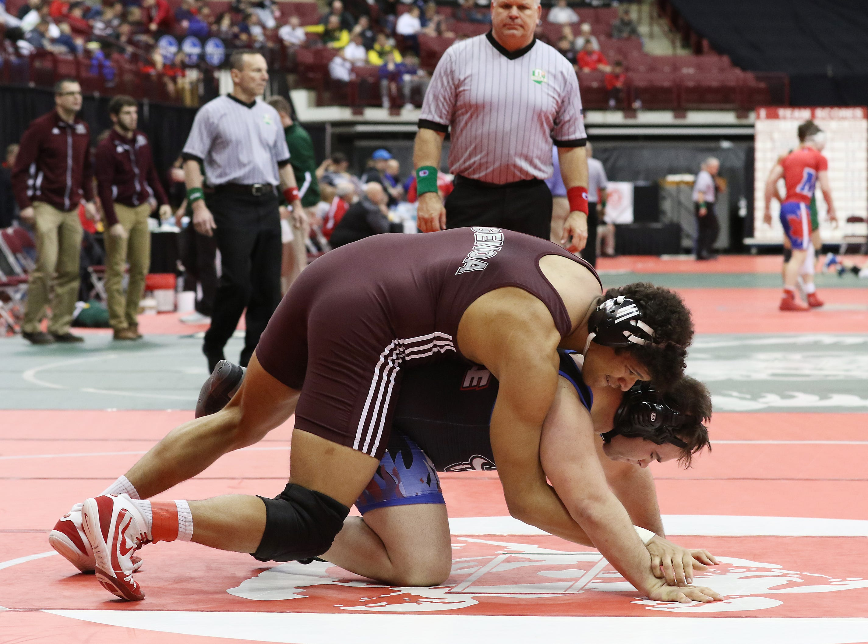 Genoa's Noah Kock wrestles Danville's Dylan Wilson in the 285 pound weight class during the Division III consolations at the state wrestling tournament on Friday.