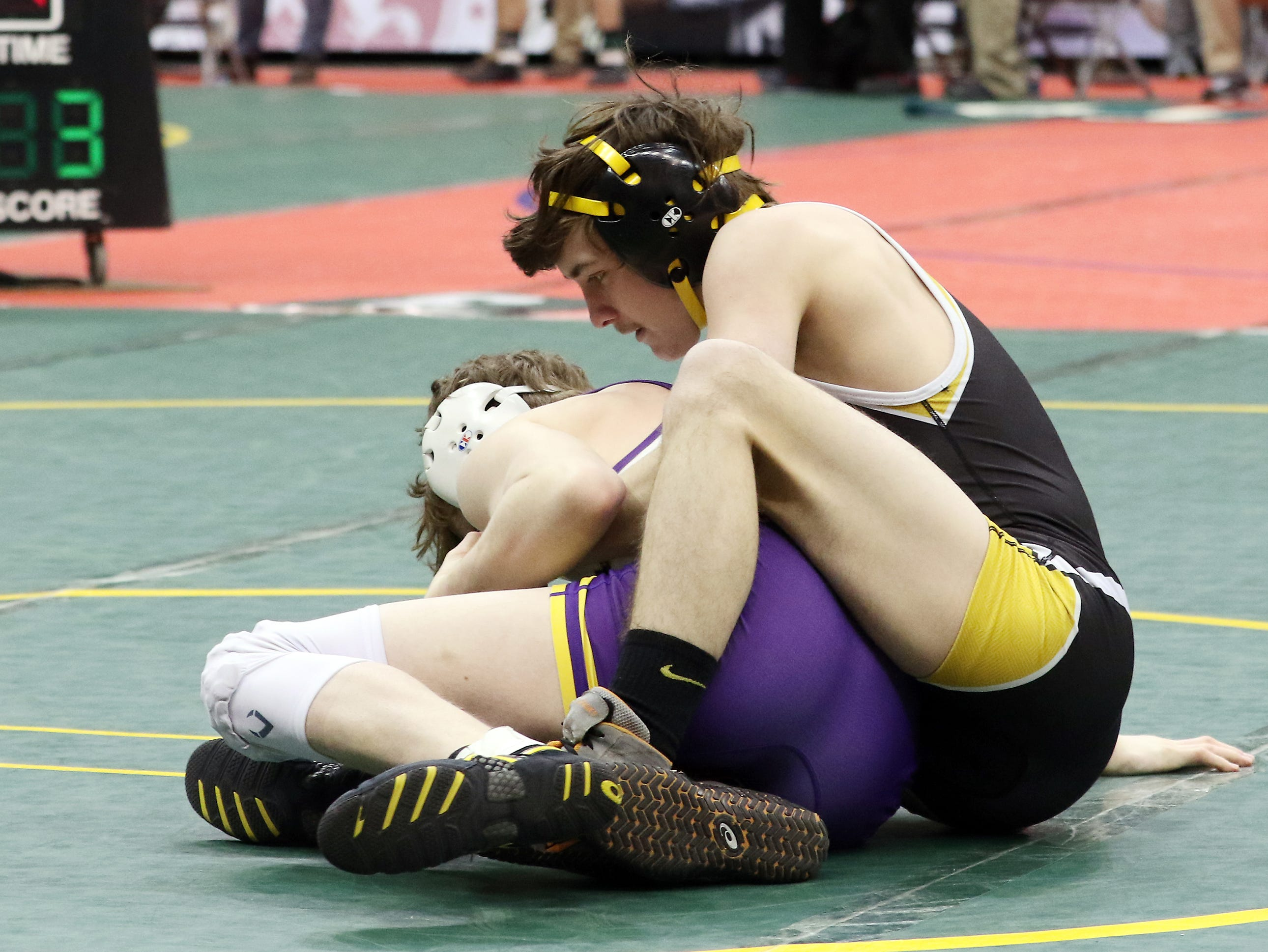 Tri-Valley's Sky Wisecarver wrestles Avon's Cael Saxton in the 106 pound consolations at the Division I state wrestling tournament on Friday.