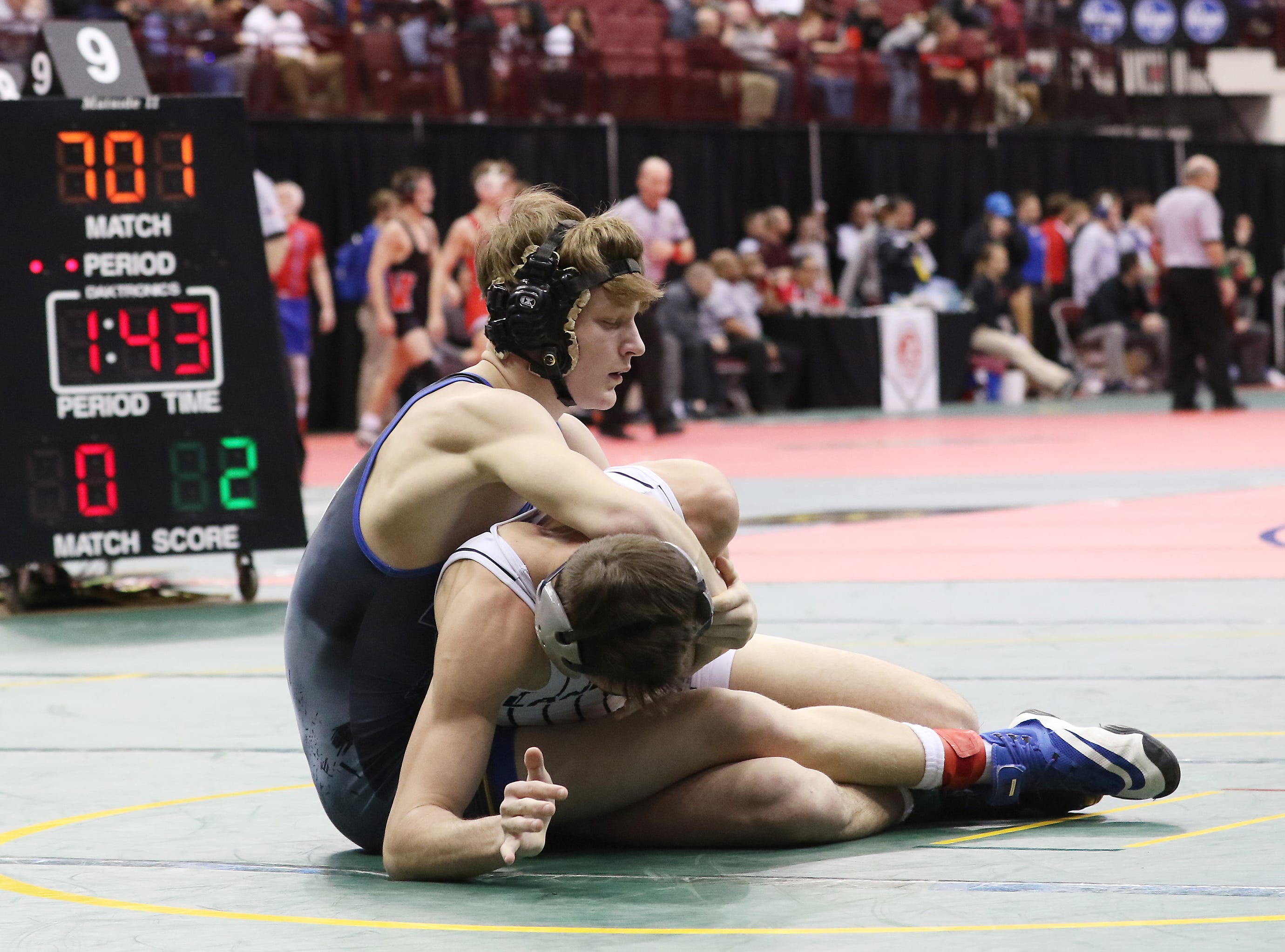 West Muskingum's Andrew Knaup wrestles in Blanchester's Clayton Schirmer in the 152 pound Division III consolations at the state wrestling tournament on Friday.