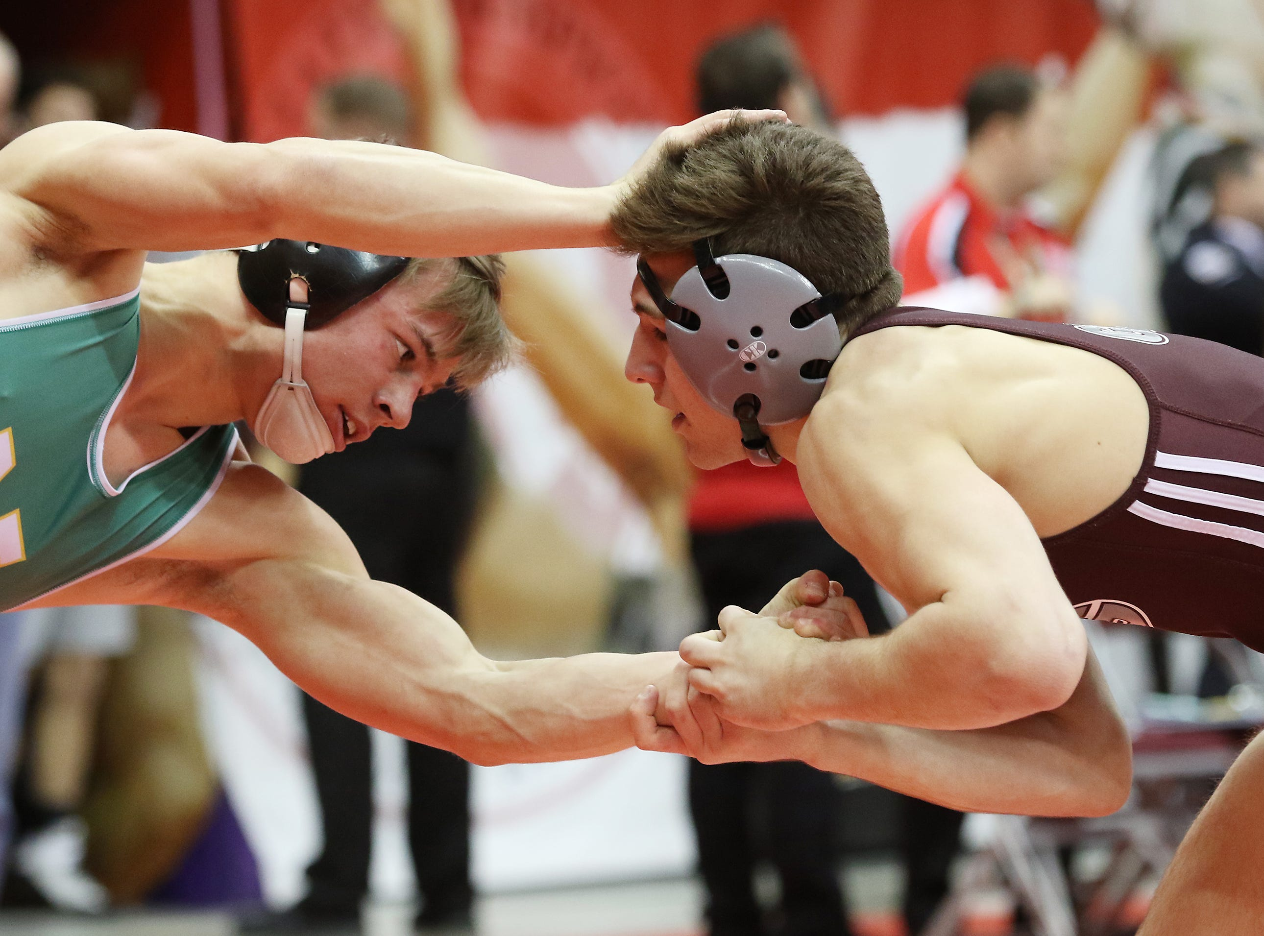 Newark Catholic's J.T. Brown wrestles Genoa's Dylan D'Emilio in the 138 pound weight class at the Division III state wrestling tournament on Friday.