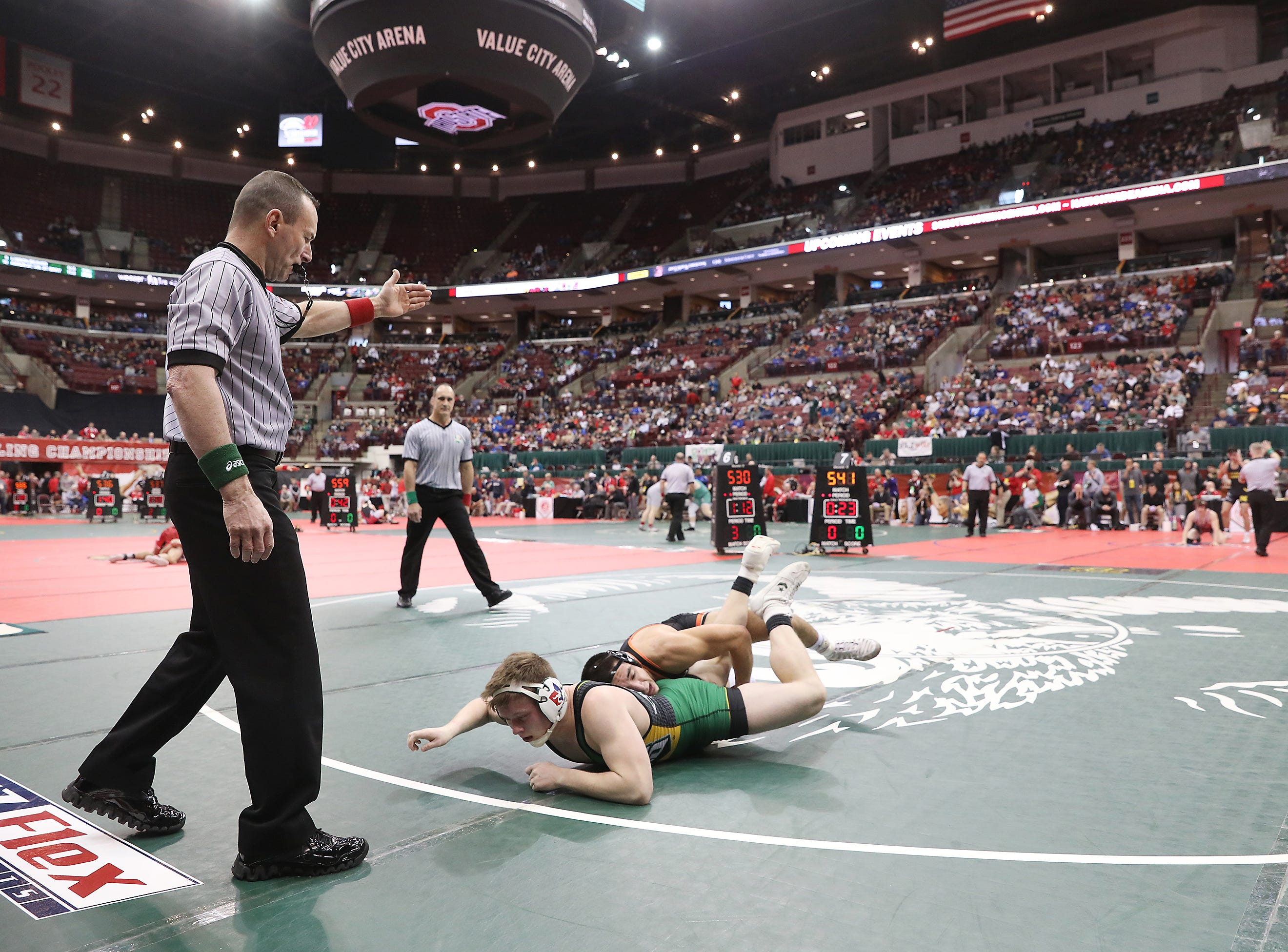 Gibsonburg's Brad Mendoza wrestles Troy Christian's Craig Montgomery in the 170 pound weight class at the Division III state wrestling tournament on Friday.