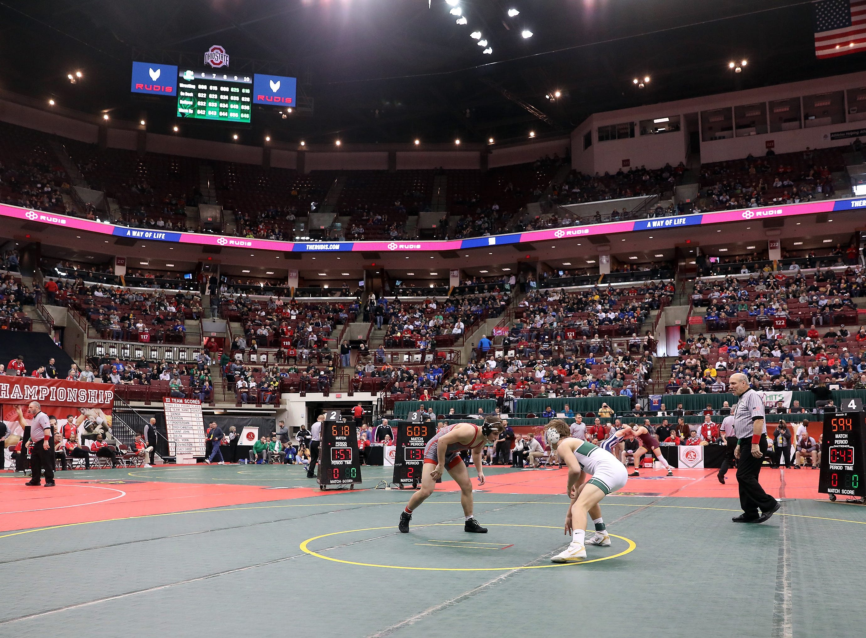Bellevue's Justin Mayes wrestles Aurora's Will McGhee in the 160 pound weight class at the Division II state wrestling tournament on Friday.
