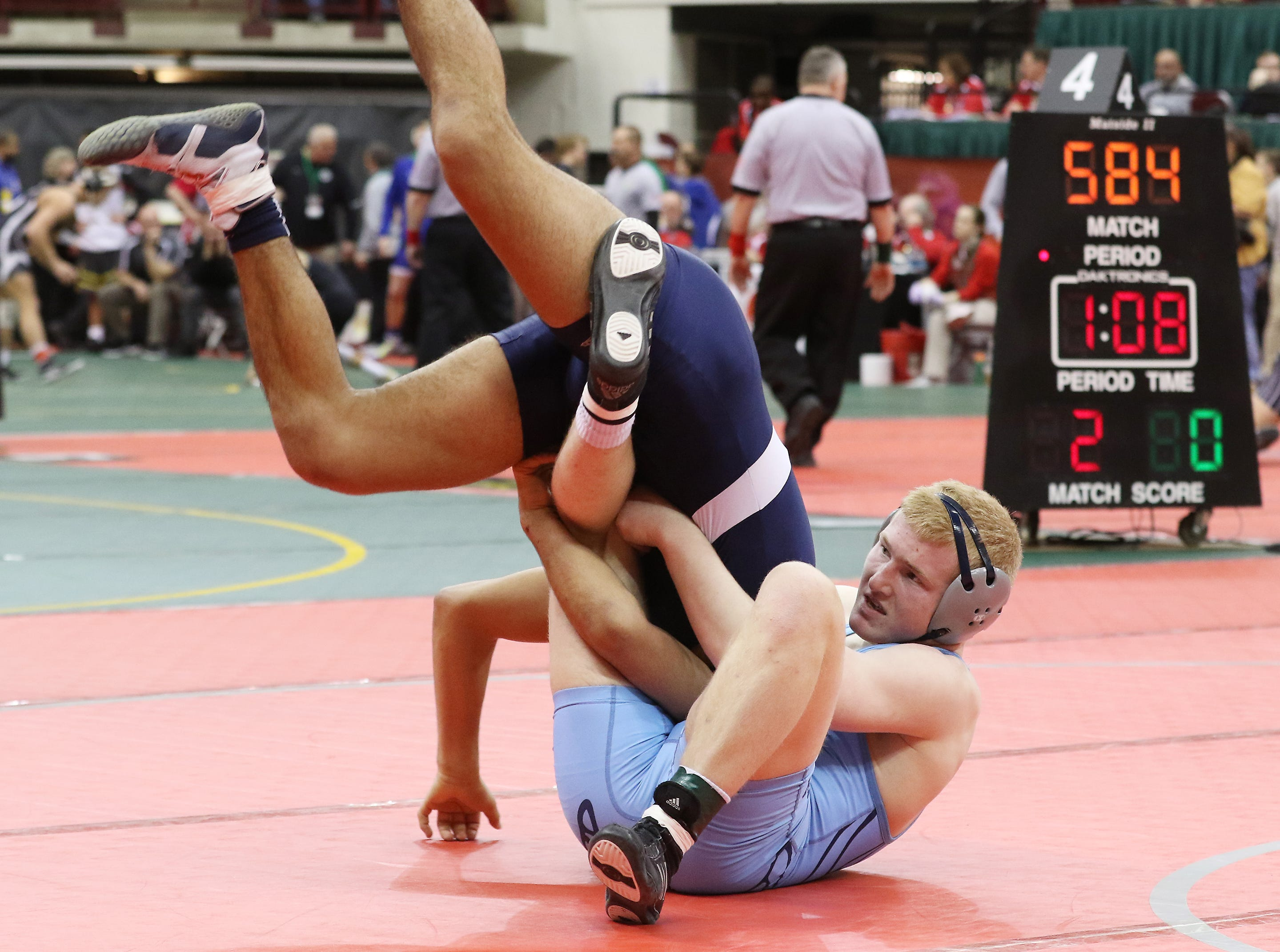 Caledonia River Valley's Hadyn Danals wrestles Norwalk's Ethan Hernandez in the 160 pound weight class.