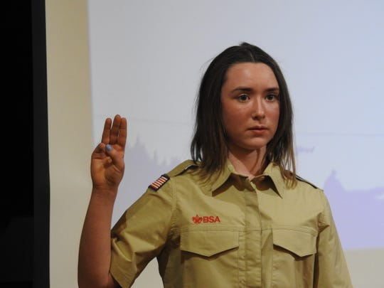Emma Norman recites the Scout Oath at the annual Muskingum Valley Council meeting.