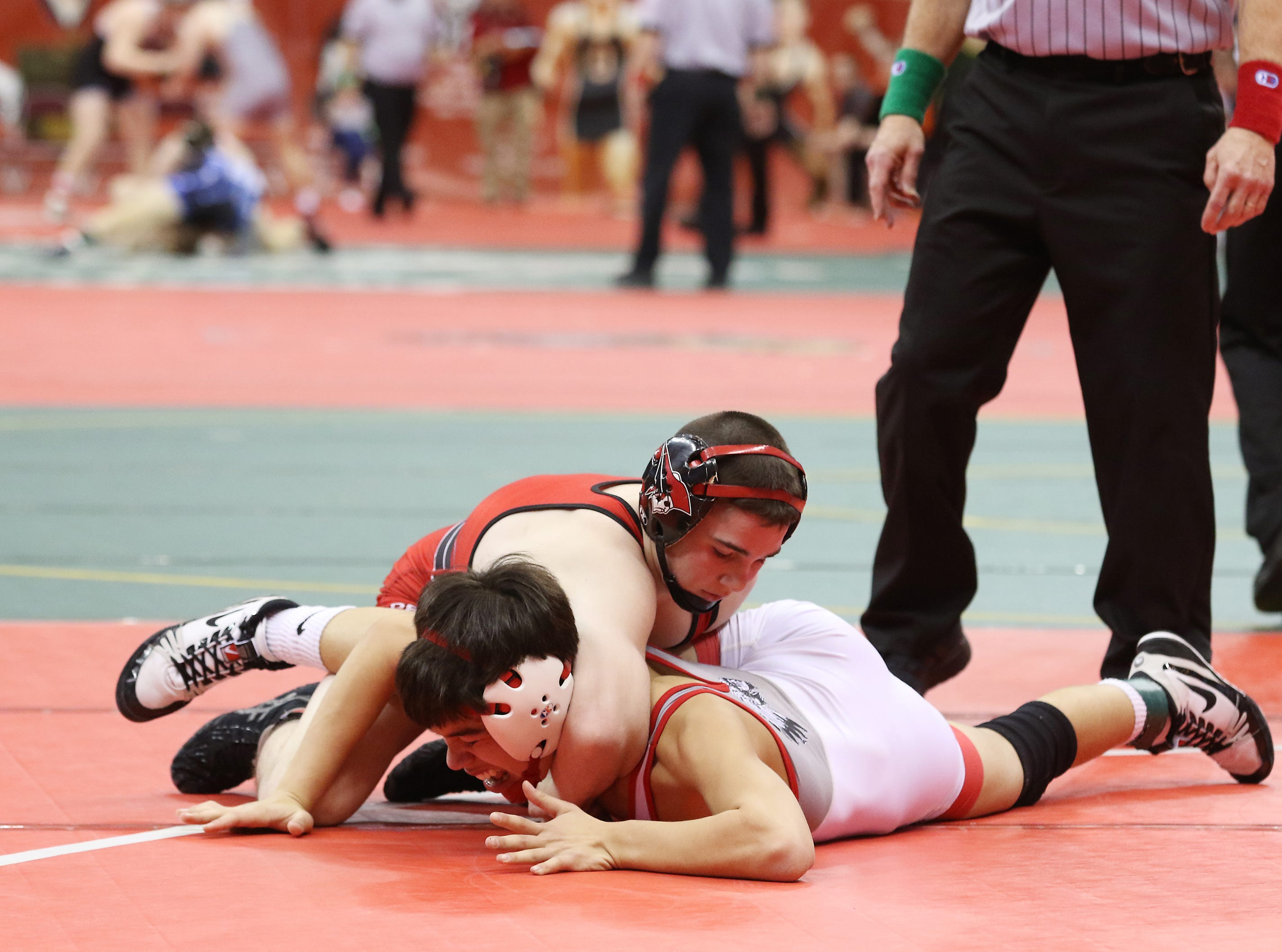 Bellevue's Gabe Alda wrestles Perry's Kyle Rowan in the 106 pound weight class at the Division II state wrestling tournament on Friday.