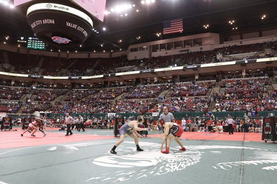Watkins Memorial's Cole Foor wrestles Elyria's Jake Evans in the 170 at the Division I state wrestling tournament on Friday.