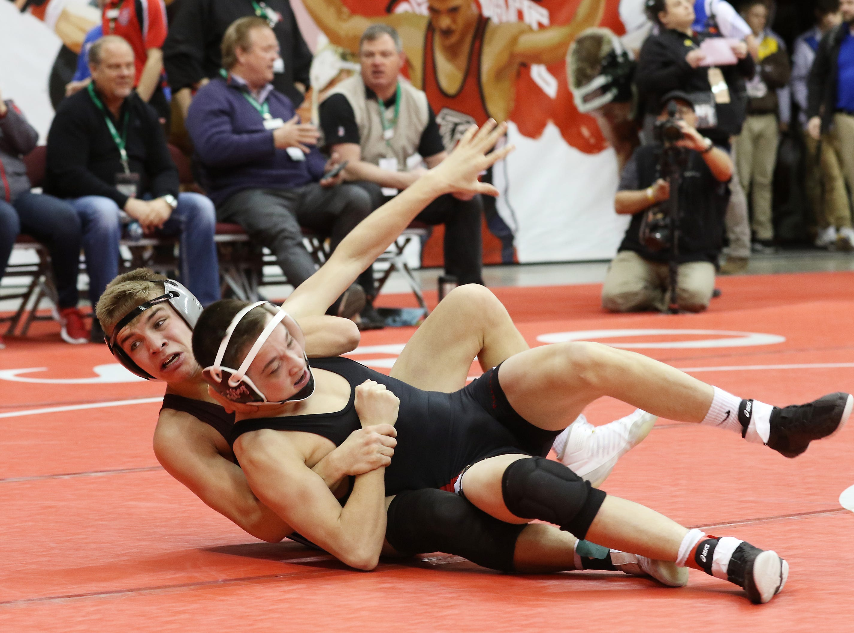 Genoa's Oscar Sanchez wrestles Cardington Lincoln's Draven Hubley in the 120 pound weight class at the Division III state wrestling tournament on Friday.