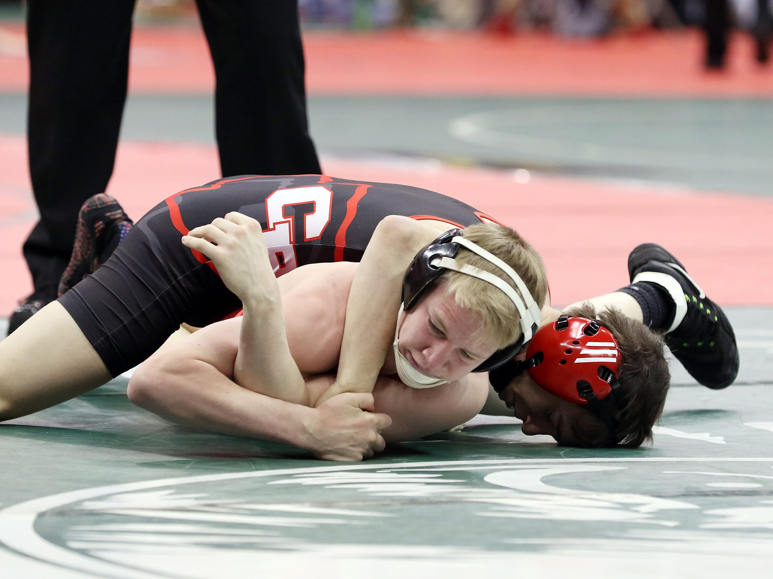 Coshocton's Lucian Brink wrestles Oak Harbor's Tyler Davis in the 113 pound weight class at the Division III state wrestling tournament in Columbus on Friday.