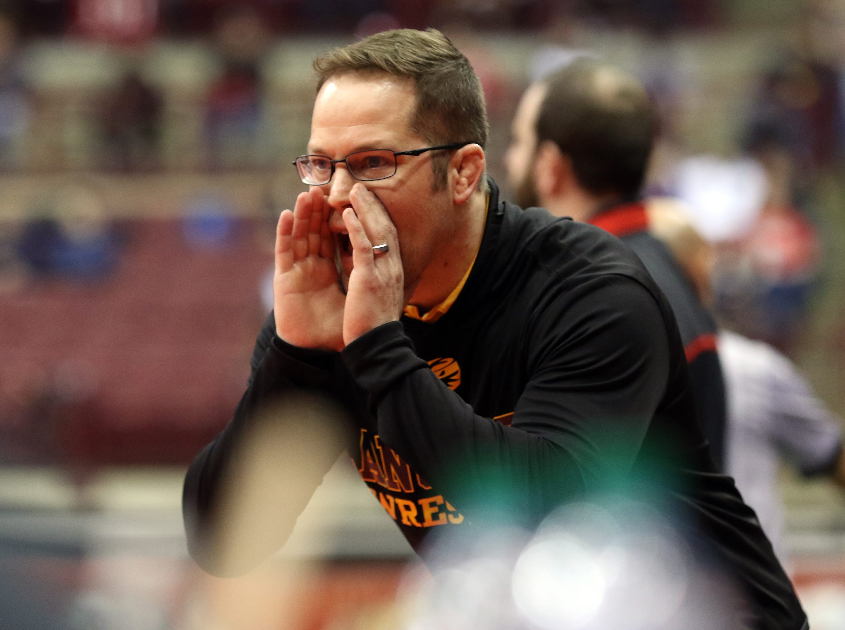A Lancaster coach shouts support to the Golden Gale's Aiden Agin.