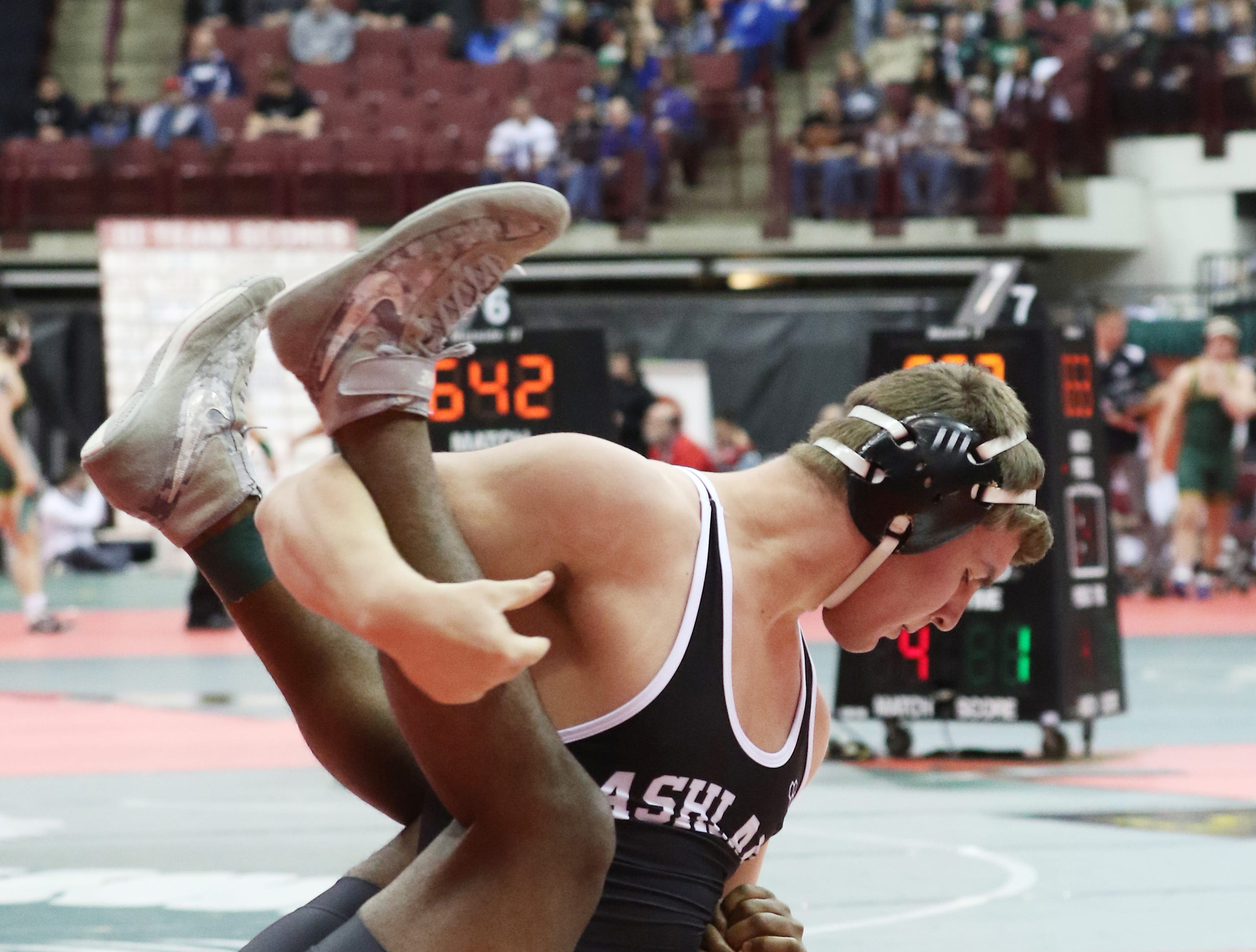 Ashland's Josh Beaver wrestles Clayton Northmont's Bryan Heyward in the 220 pound weight class at the Division I state wrestling tournament in Columbus on Friday.