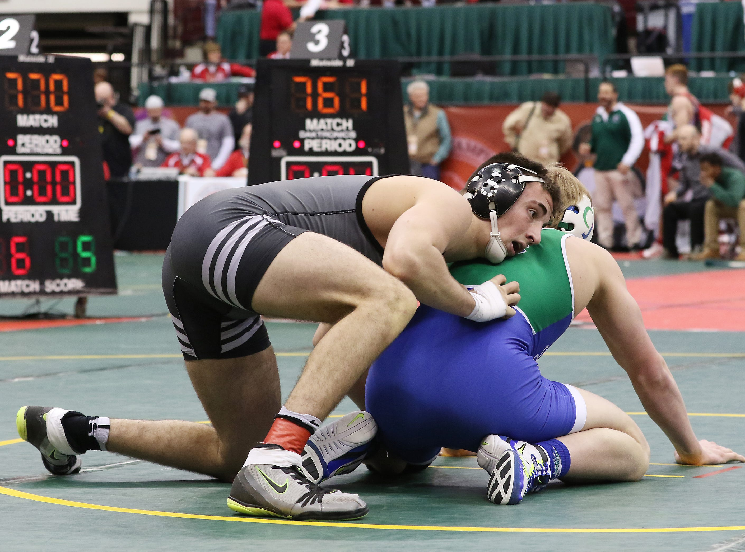 Sheridan's Chance King wrestles Dayton Chaminade Julienne's Hunter Johns in the 182 pound consolations at the Division II state wrestling tournament on Friday.