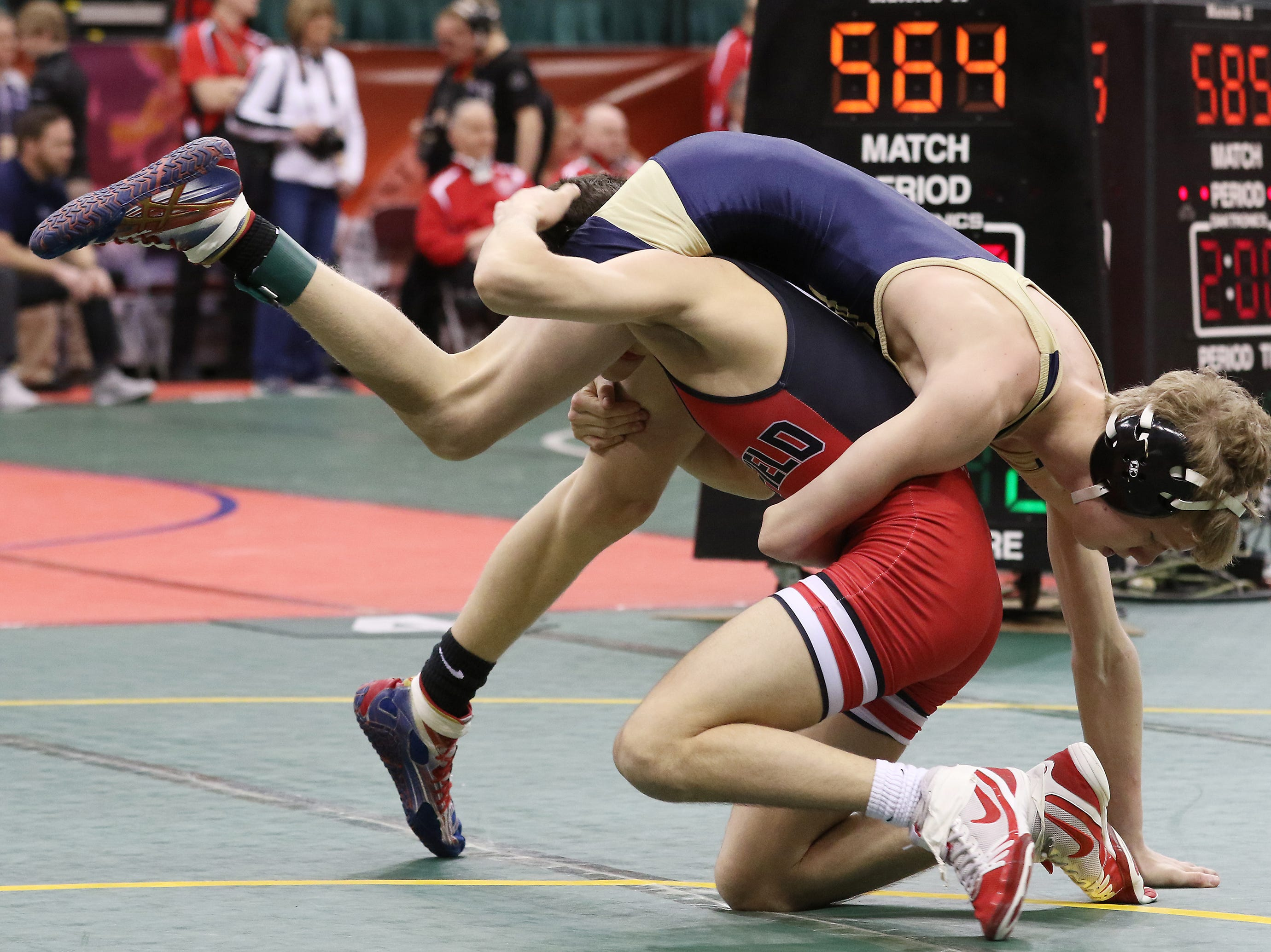 Caldonia River Valley's Blake Cerny wrestles Canfield's Nick Barber in the 106 pound weight class at the Division II state wrestling tournament on Friday.
