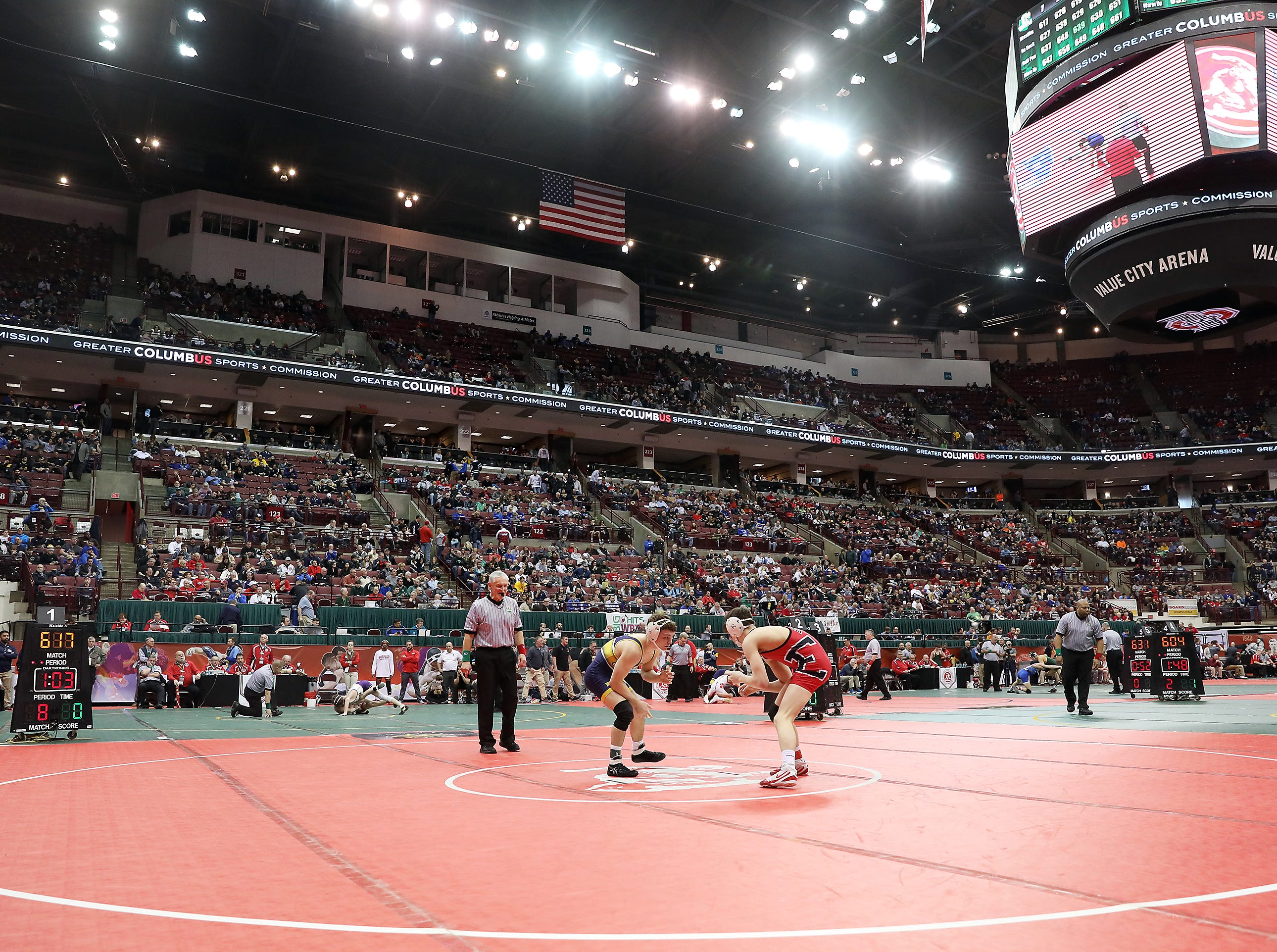 Lancaster's Aiden Agin wrestles Elyria's Nate Burnett in the 120 pound weight class at the Division I state wrestling tournament on Friday.