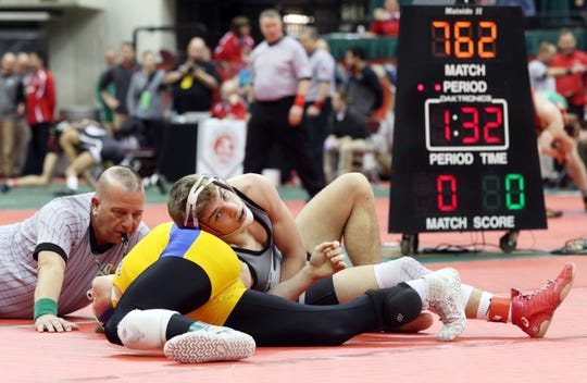 Sheridan's Jordan Barnett wrestles Ontario's Ethan Turnbaugh in the 145 pound consolations at the Division II state wrestling tournament on Friday.