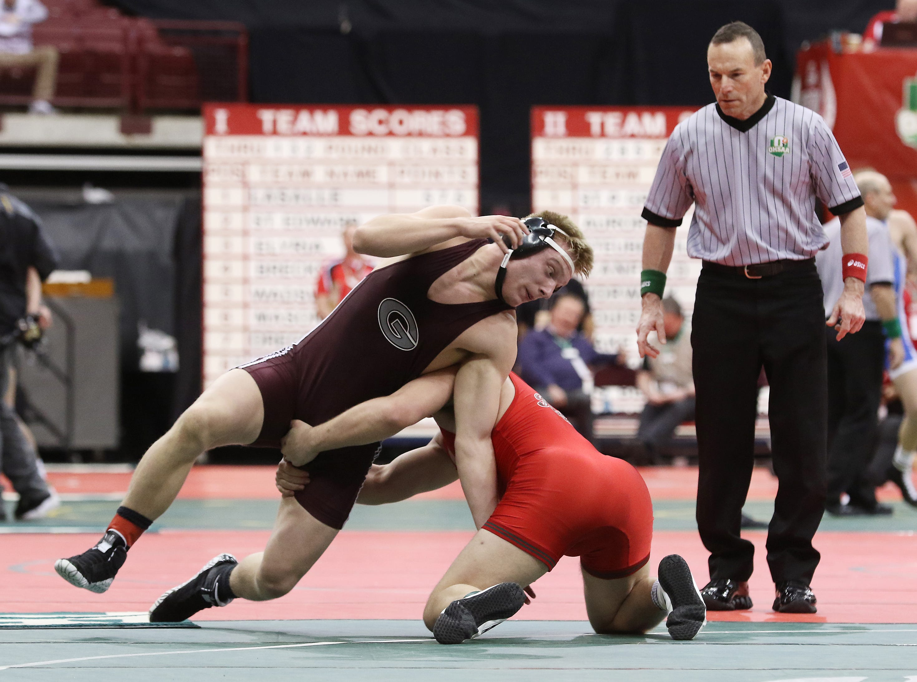 Genoa's Brian Martin wrestles Oak Harbor's Jake Sage during the Division III consolations at the state wrestling tournament on Friday.