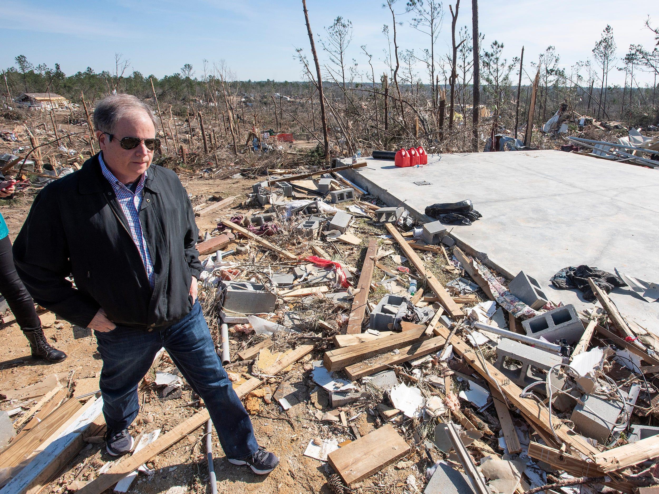Sen. Doug Jones, D-Ala., tours tornado damage in Beauregard, Ala., on March 7, 2019.