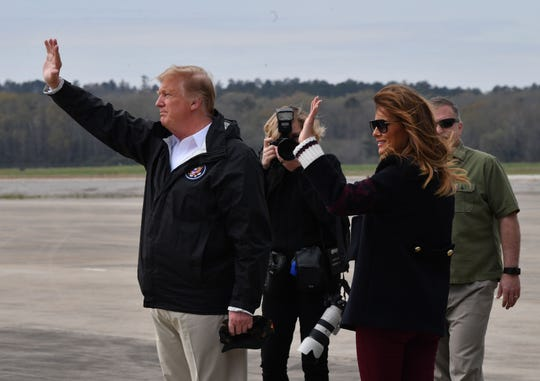 President Donald Trump and first lady Melania Trump arrive at Fort Benning, Georgia, March 8, 2019 en route to areas in Alabama affected by recent tornado damage. (Photo by Nicholas Kamm / AFP)