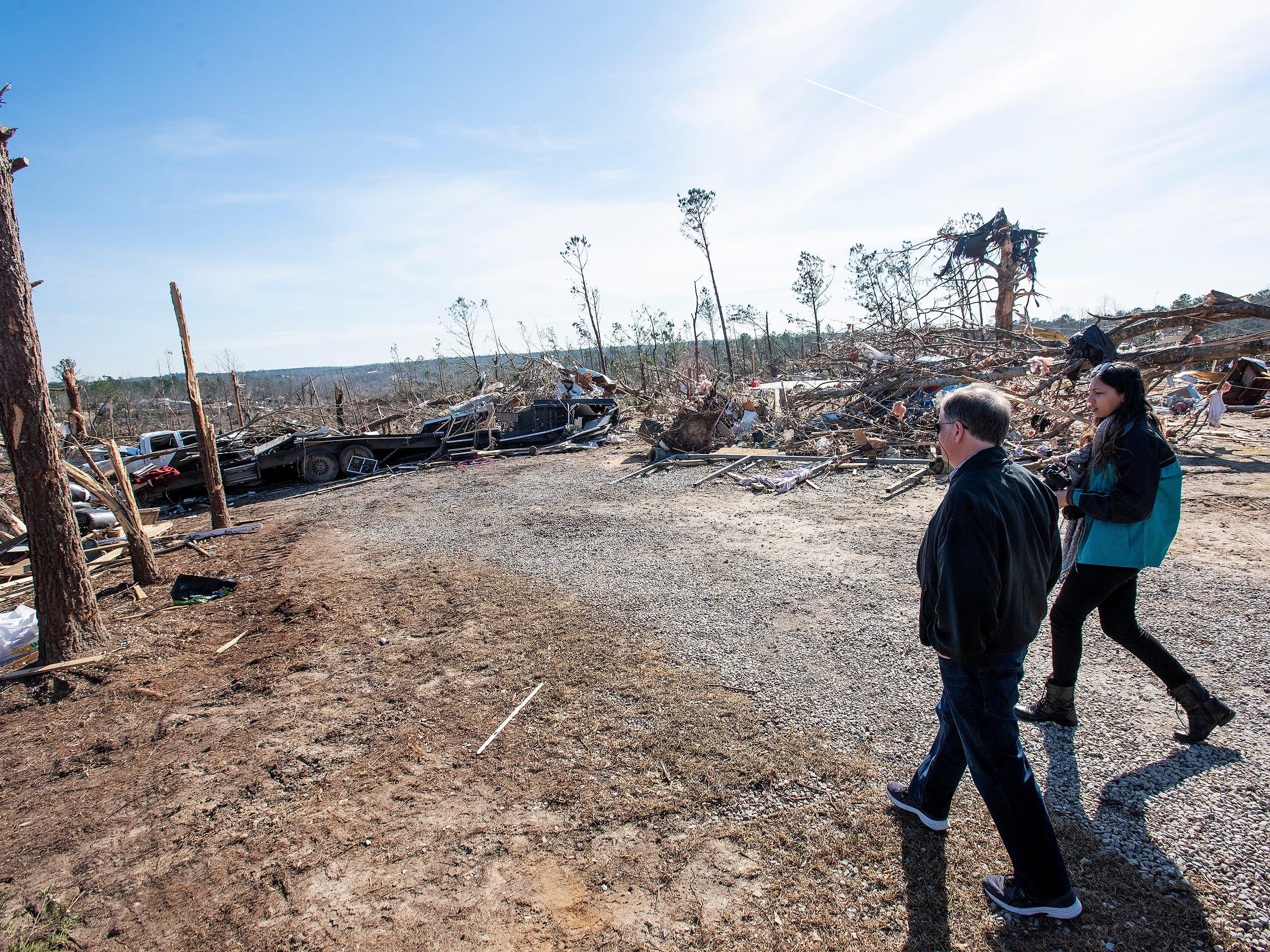 Sen. Doug Jones, D-Ala., tours the tornado damaged area in Beauregard, Ala., on Thursday March 7, 2019.