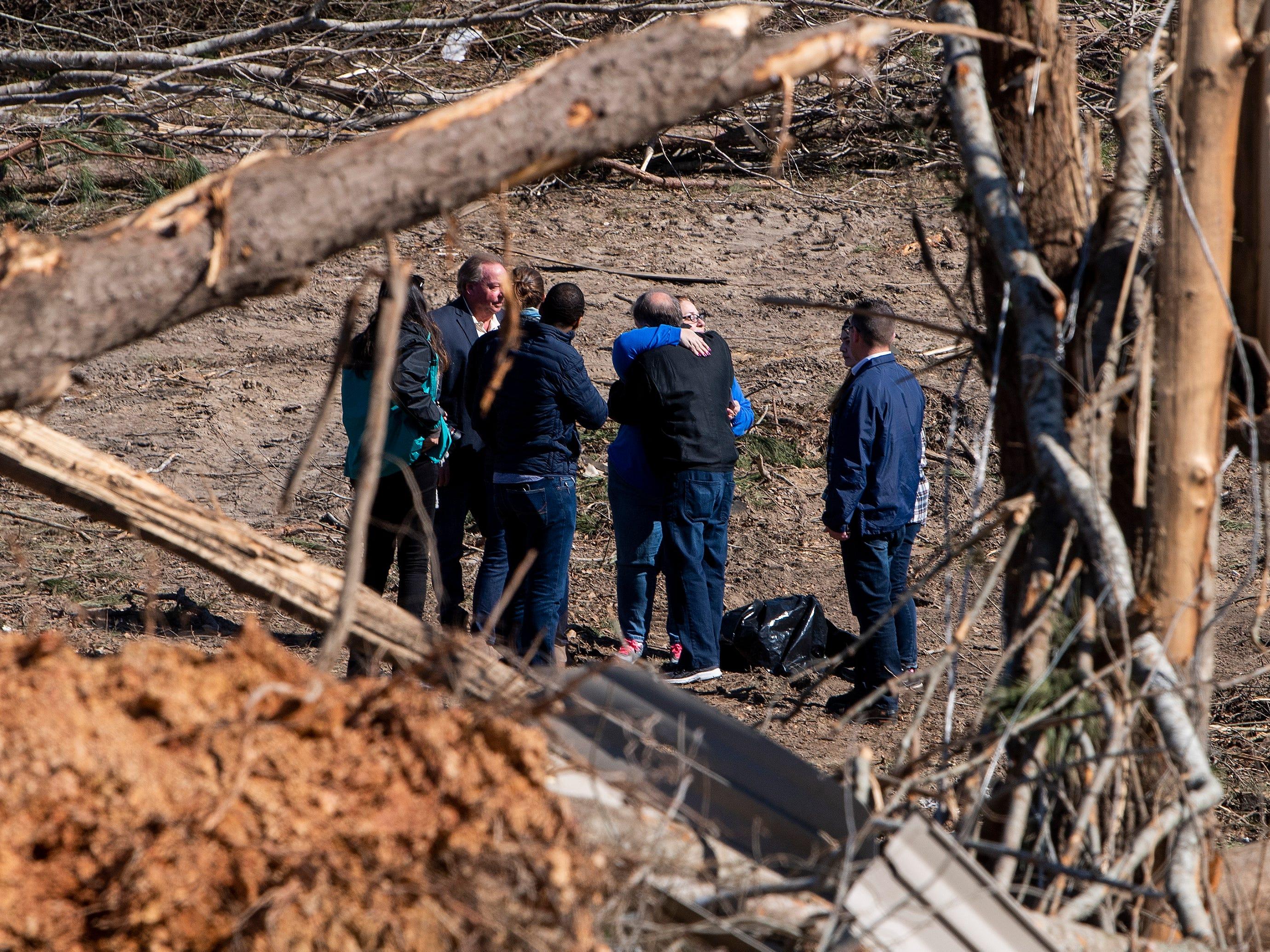 Sen. Doug Jones, D-Ala., hugs a resident as he tours tornado damage in Beauregard, Ala., on March 7, 2019.