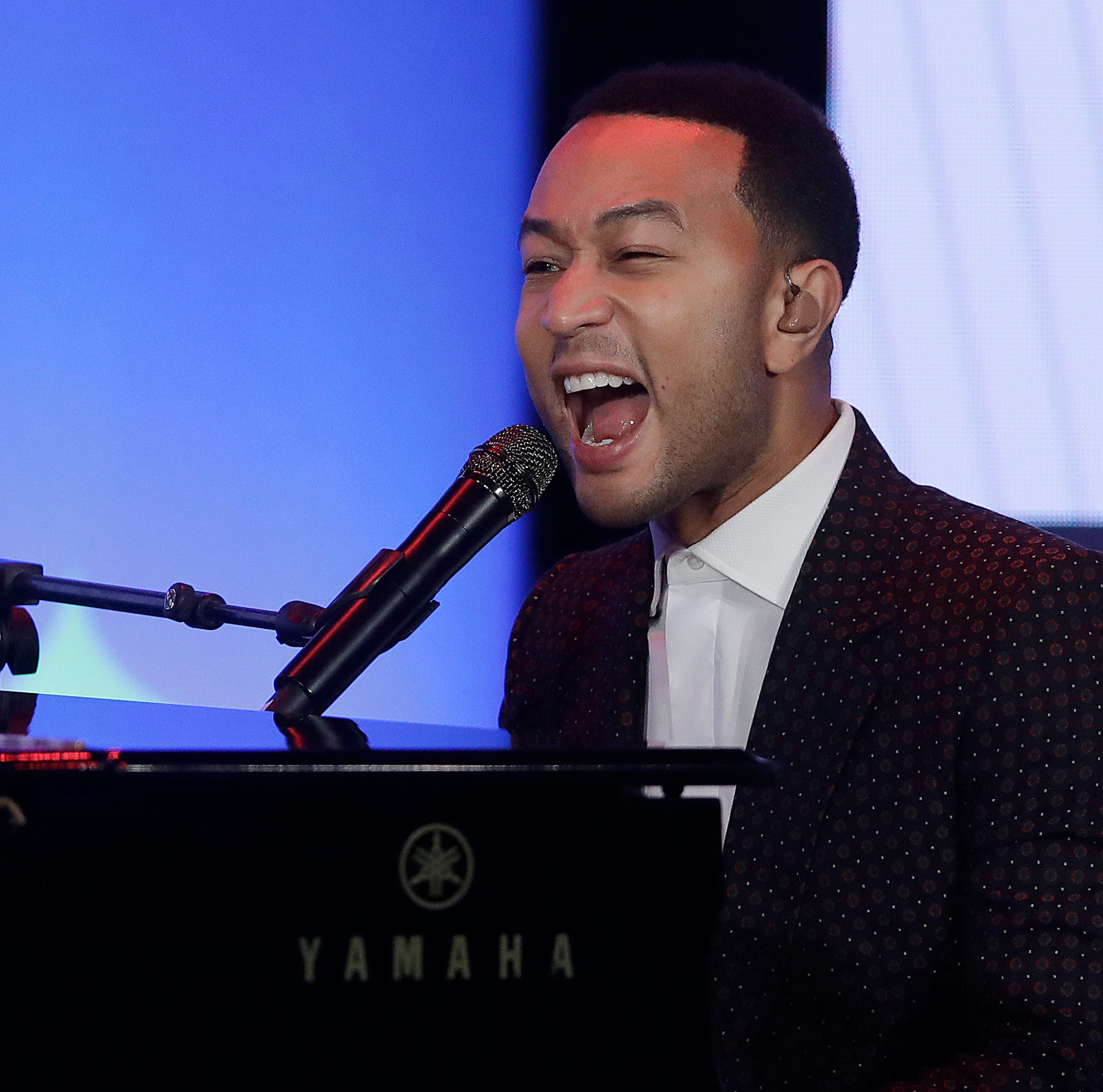 "John Legend's son Miles sings into a toy microphone to ""Wheels on the Bus."""