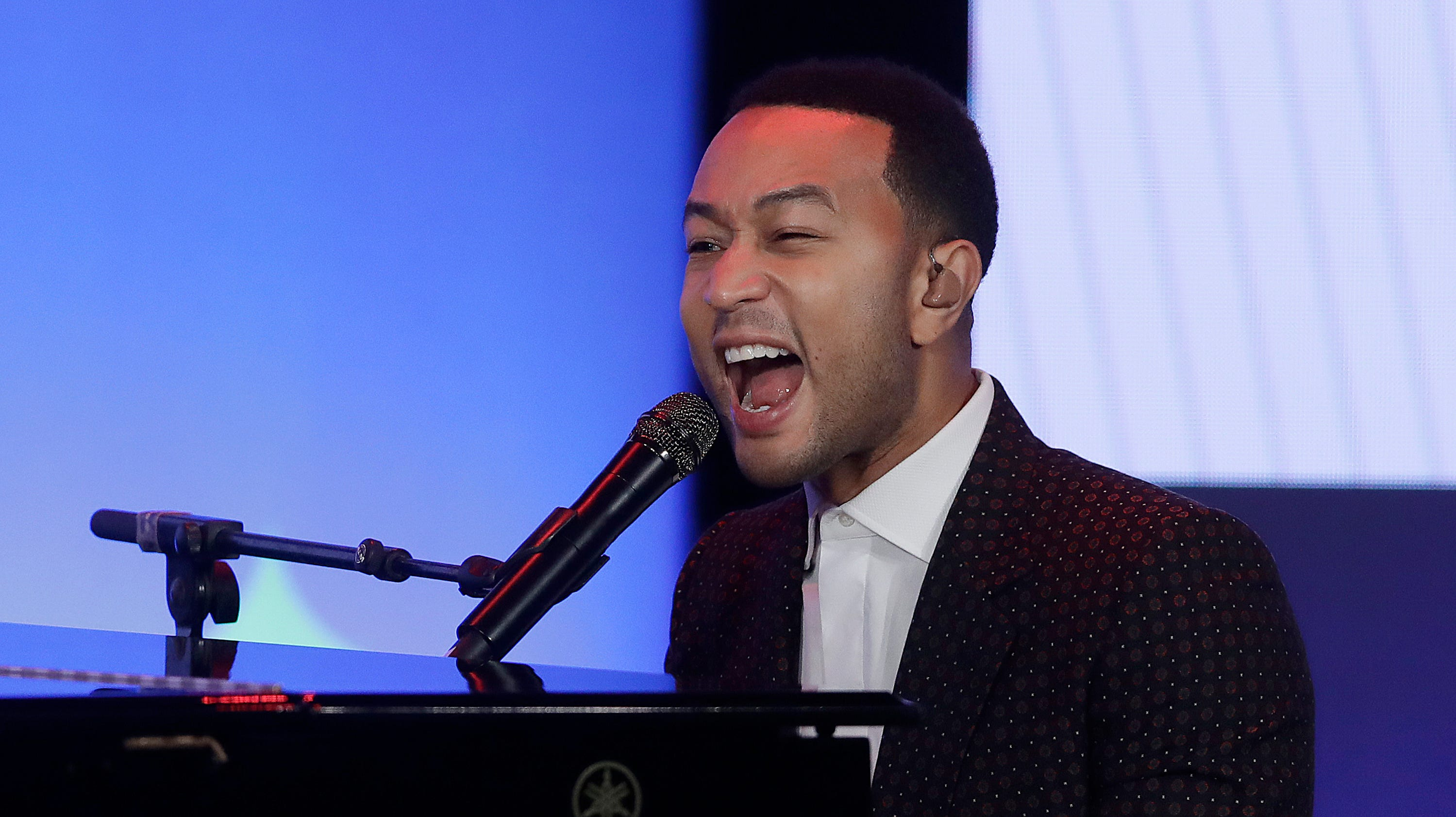 John Legend's son Miles practices for future Grammy Award singing 'Wheels on the Bus'
