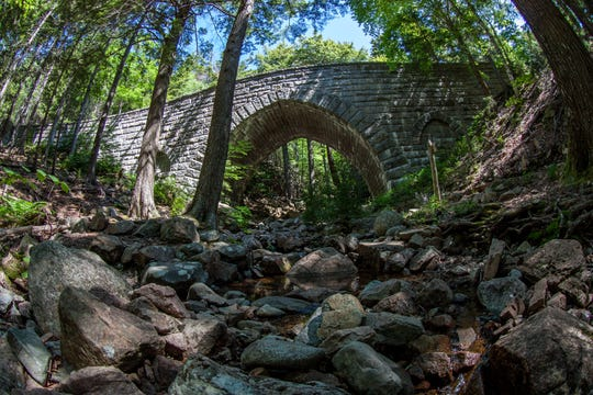 A carriage road bridge crosses a section of Acadia National Park.