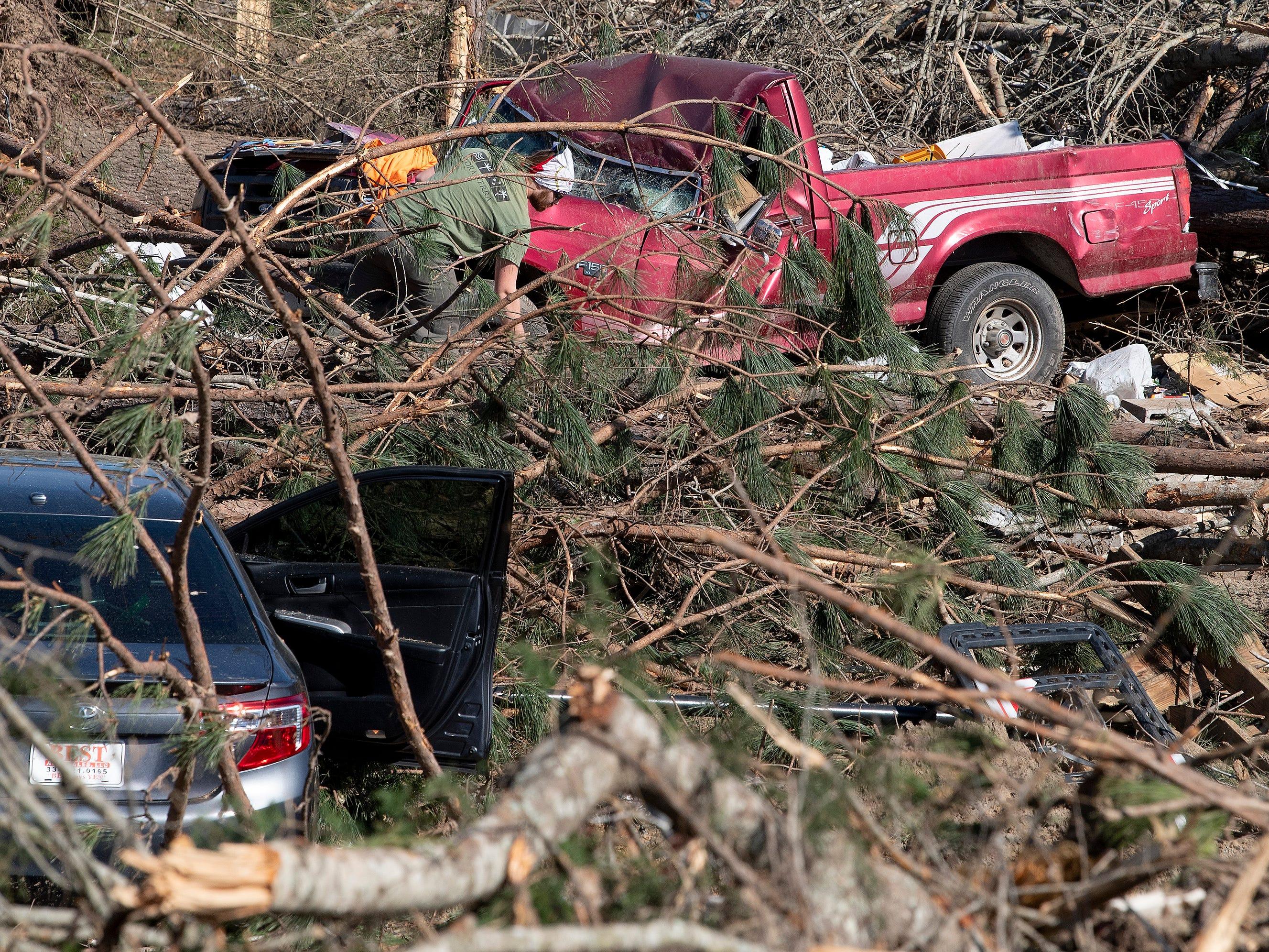 Residents clean up debris in Beauregard, Ala., on March 7, 2019.