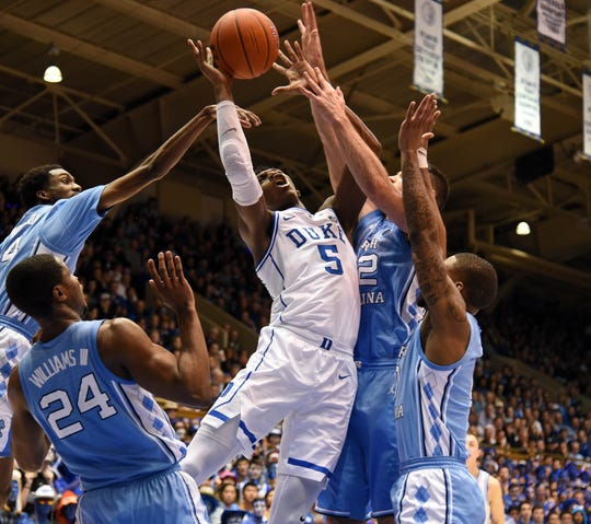 Duke forward R.J. Barrett is fouled by North Carolina forward Luke Maye (32) during their game at Cameron Indoor Stadium.