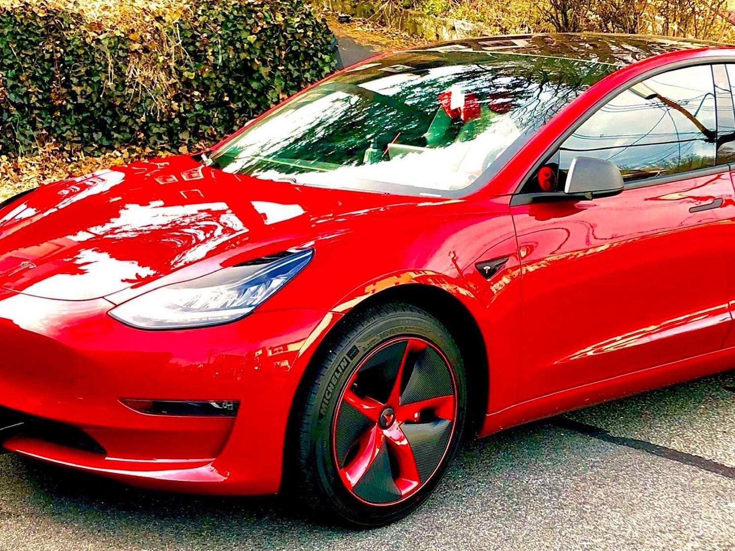 """Ruby Rose"" is Adam Etkin's 2018 long-range, rear wheel drive Tesla Model 3, with chrome delete and custom Aero wheel covers."