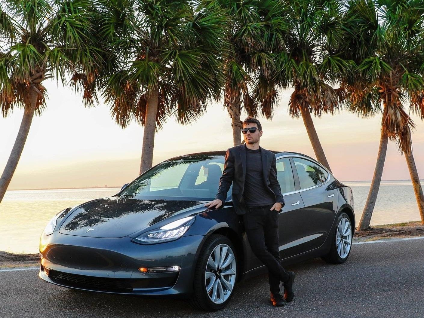 "Ryan's Model 3 in St. Petersburg, Florida, October 2018. He's had the car since June and says it's his ""favorite thing.""    ""The car is constantly evolving and they provide the updated features for free. Not even the iPhone gives you that much with an update without purchasing a new model.""  He's a big fan of the self-driving capabilities: ""I don't know how I drove before without it. I used to dread long drives or driving in traffic, but this makes it so simple and easy."""