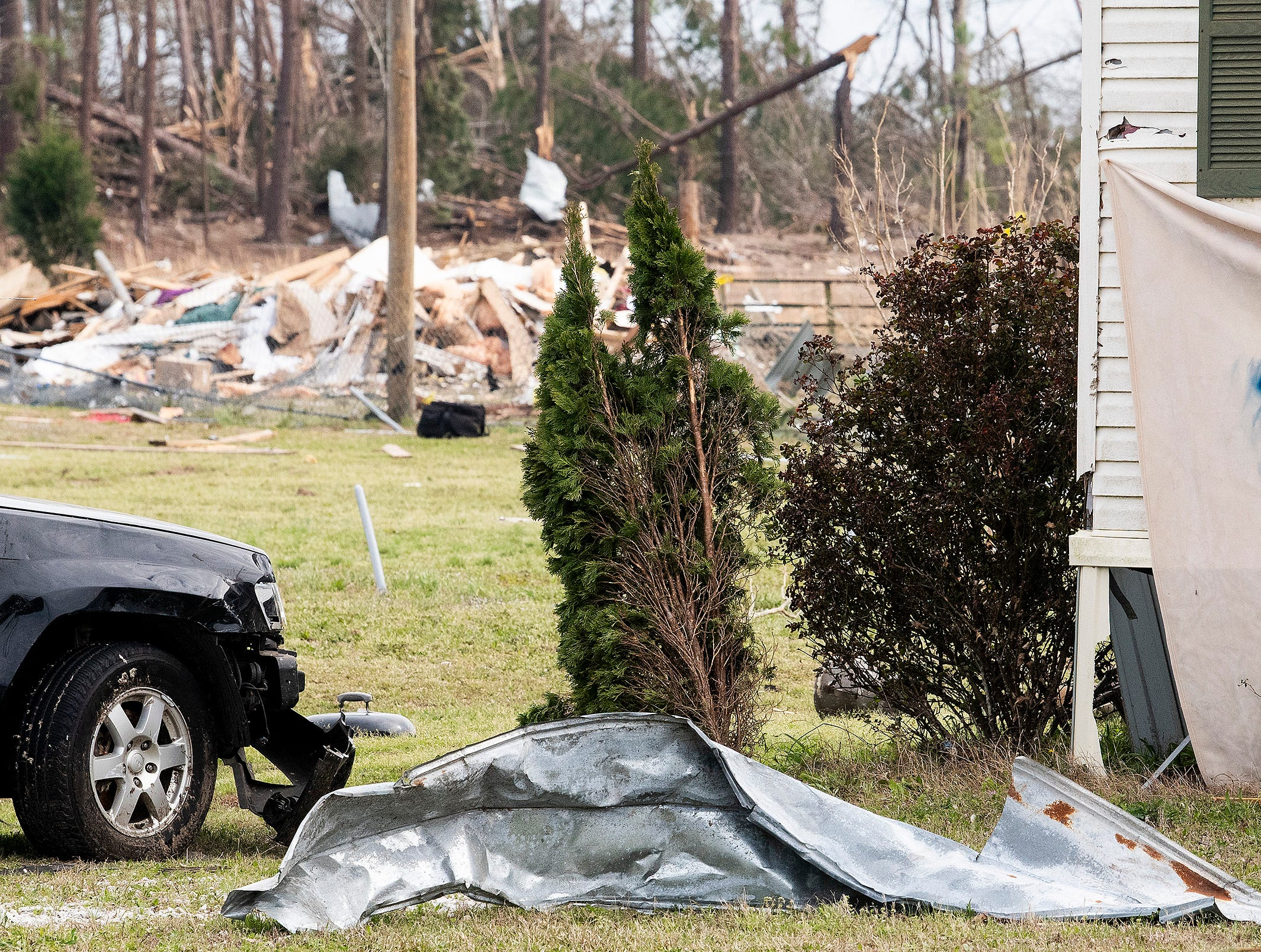 A sign hangs from a damaged mobile home in Beauregard, Ala., on Friday March 8, 2019.