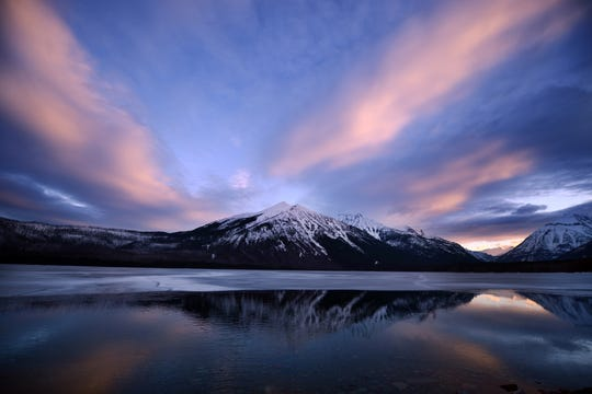 A snowy sunrise over Lake McDonald in Glacier National Park.
