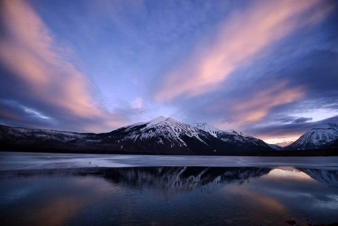A snowy sunrise over Lake McDonald in Glacier National Park.