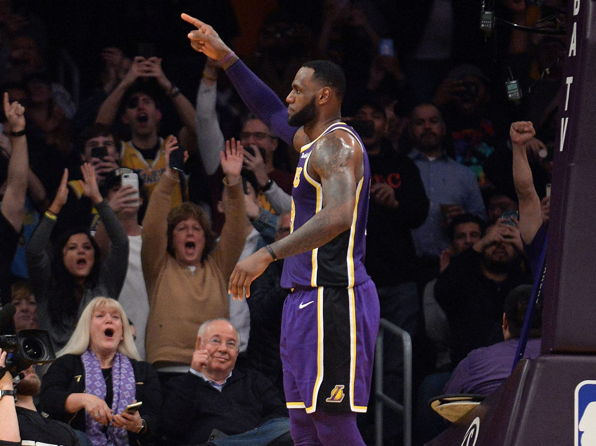 March 6: Lakers forward LeBron James celebrates after hitting a driving layup to pass Michael Jordan for fourth place on the NBA's all-time scoring list.