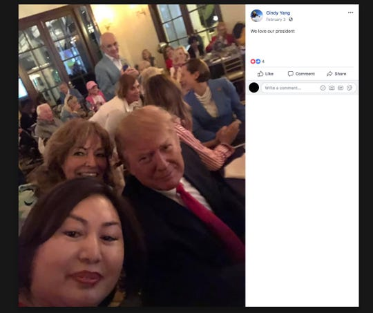This is a frame grab for the Facebook page of Li Yang, 45, showing a selfie she snapped with Trump from the Super Bowl watch party, held at the president's West Palm Beach, Florida, country club, the Miami Herald reported Friday, March 8, 2019. Yang also is known as Cindy Yang.