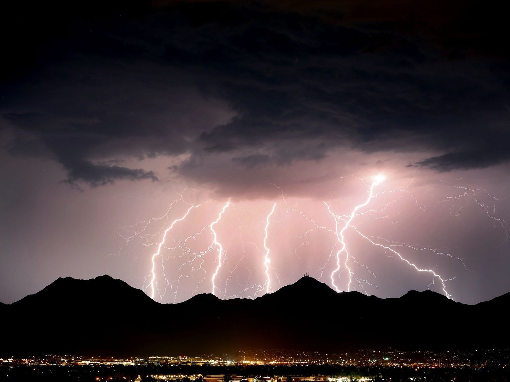 Lightning streaks across the desert sky over the McDowell Mountains near Scottsdale, Ariz. during a monsoon storm on July 15, 2017. [Via MerlinFTP Drop]