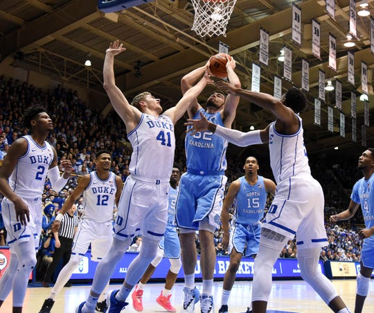 North Carolina forward Luke Maye (32) shoots the ball over Duke forward Jack White (41) during the first half at Cameron Indoor Stadium.