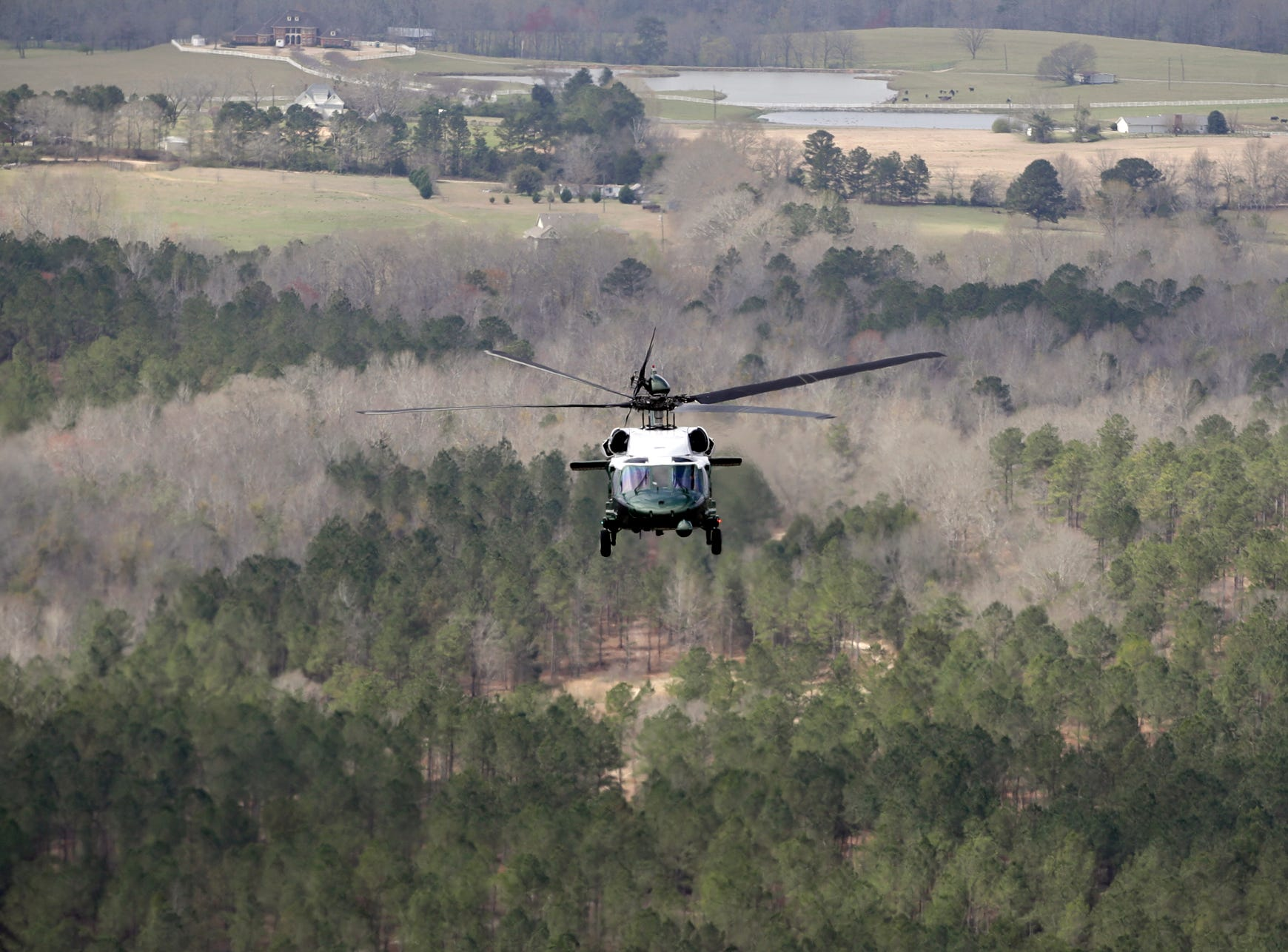 Marine One, with President Donald Trump onboard, flies near damaged areas while en route to Auburn, Ala., Friday, March 8, 2019.