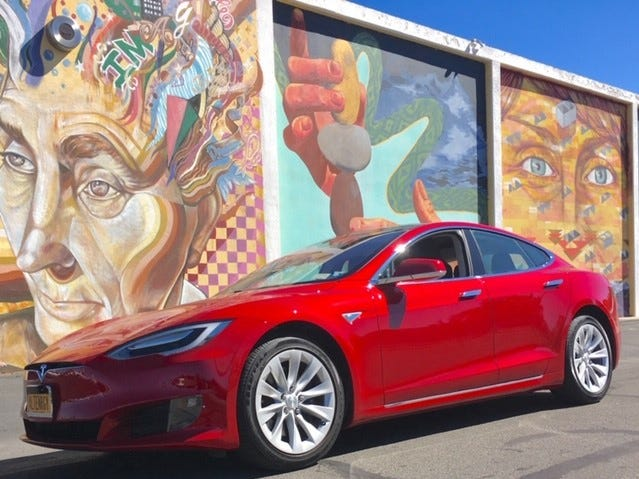 "This is ""Marvin,""  a Model S that Kristy Eisele bought in 2016 and drove from New York to California and back to take her son to college. This shot was taken in Reno, Nevada.  ""[B]eing able to put the car in Autopilot takes away a lot of stress of driving long distances,"" she says. ""At the end of the day, I can arrive at my destination and not be exhausted."""