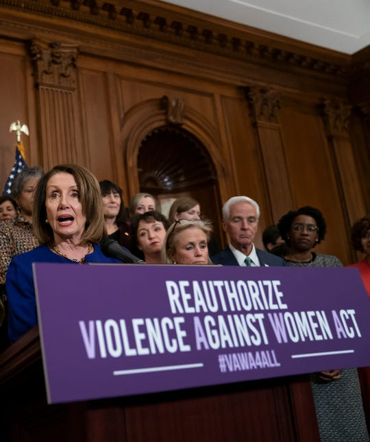 House Speaker Nancy Pelosi, joined by Reps. Katie Porter, Debbie Dingell and others, speaks about reauthorizing the Violence Against Women Act on March 7, 2019.