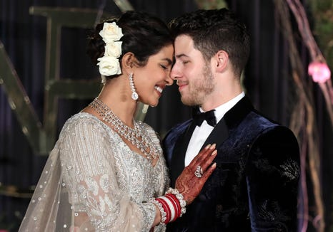 Priyanka Chopra and Nick Jonas pose during a December ceremony.