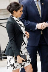 Duchess Meghan arrives for the Queen's Commonwealth Trust's International Women's Day event Friday in London.