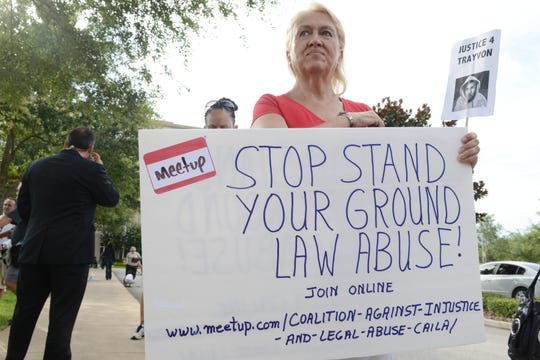 Cathy Makowski demonstrates against Florida's 'Stand Your Ground' law in front of the Seminole County Courthouse in Sanford, Fla. after the shooting death of tennager Trayvon Martin in 2013.