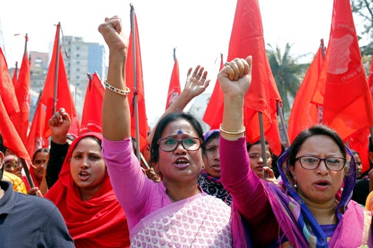 Activists from Bangladeshi women's organizations shout slogans as they participate in a International Women's Day's march in Dhaka, Bangladesh in this March 8,, 2019, file photo.
