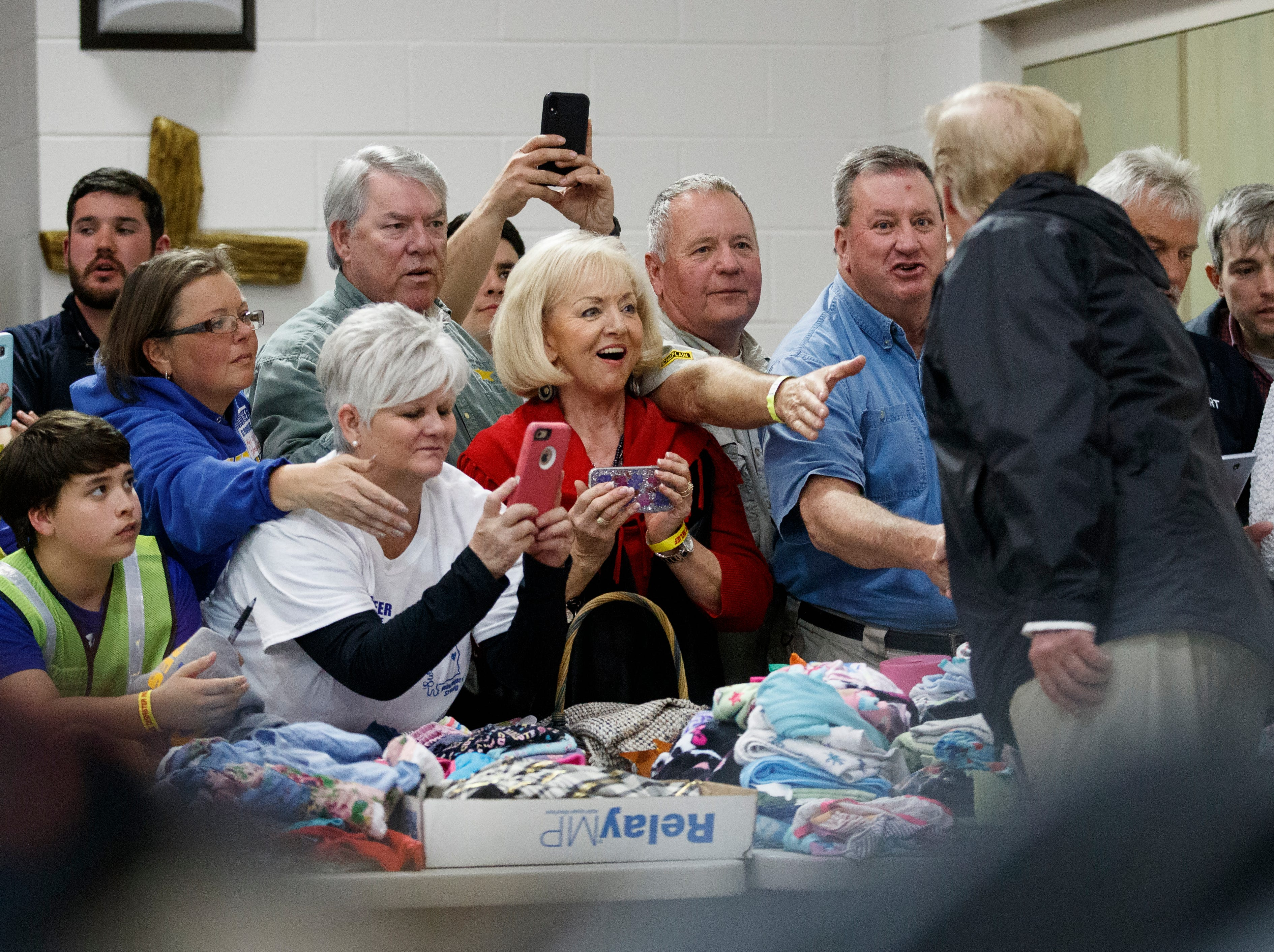 President Donald Trump greets people at Providence Baptist Church in Smiths Station, Ala., Friday, March 8, 2019.