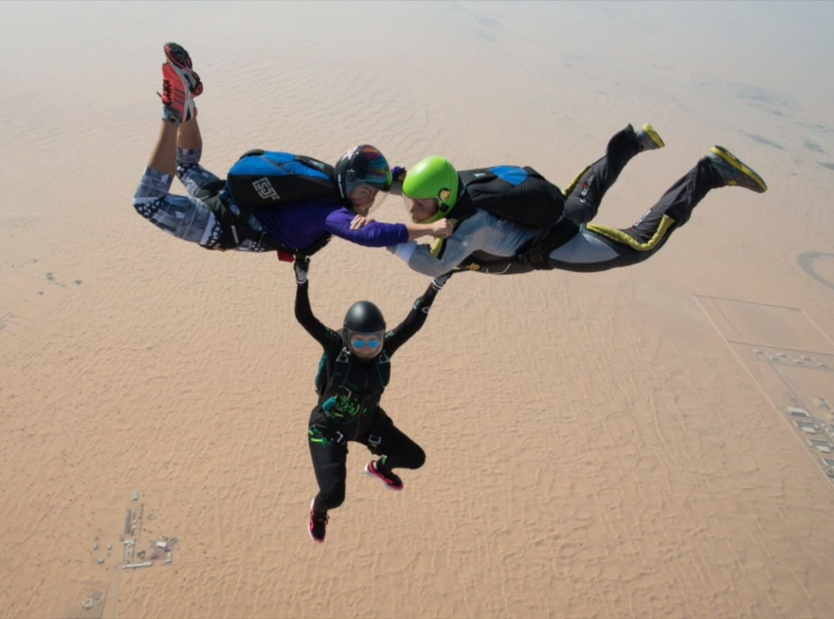 Princess Latifa, Tiina Jauhianen and an unknown third person skydive above Dubai.