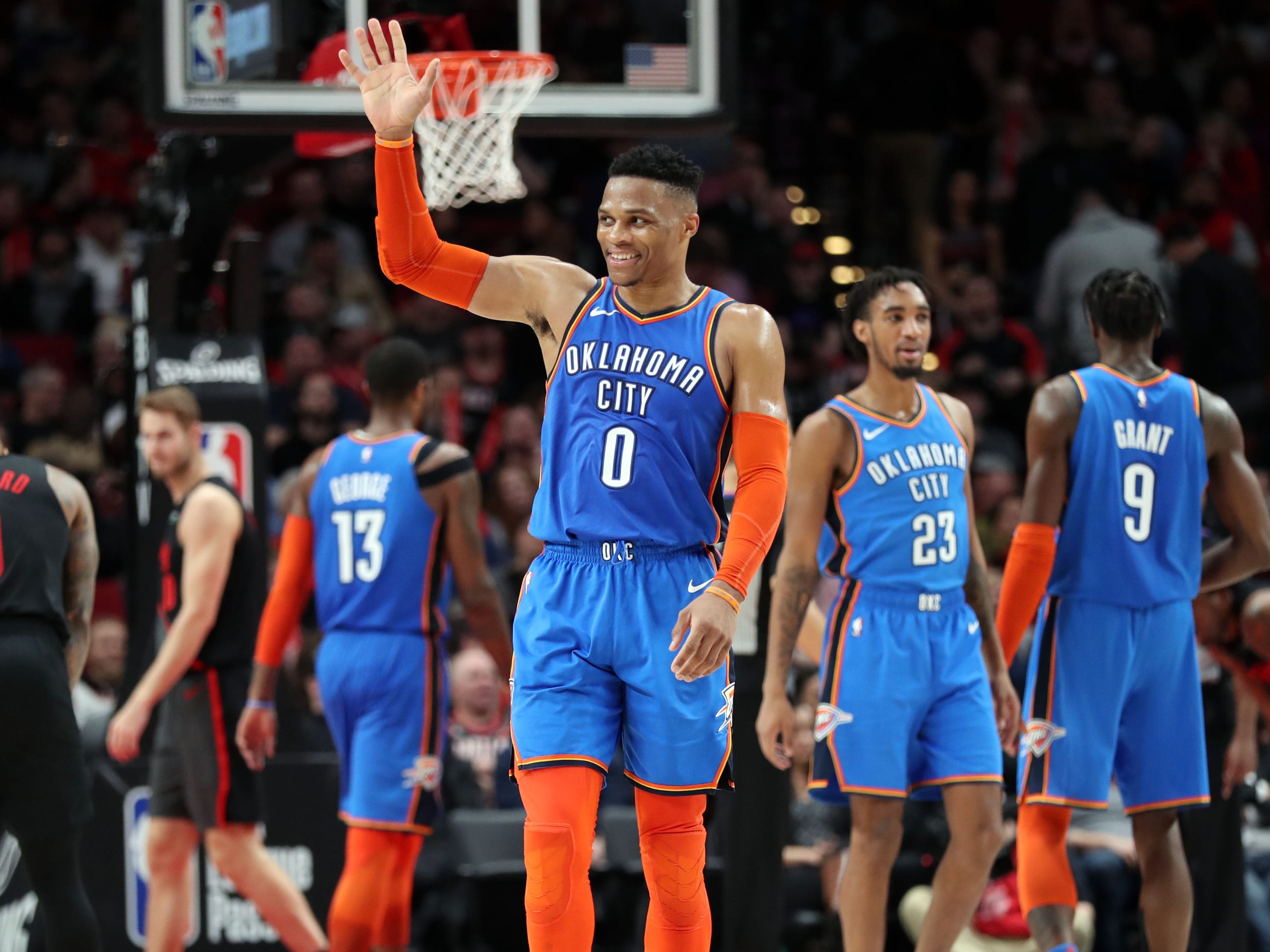 March 7: Thunder guard Russell Westbrook waves to the Portland crowd after holding off the Trail Blazers in overtime and sweeping the season series.